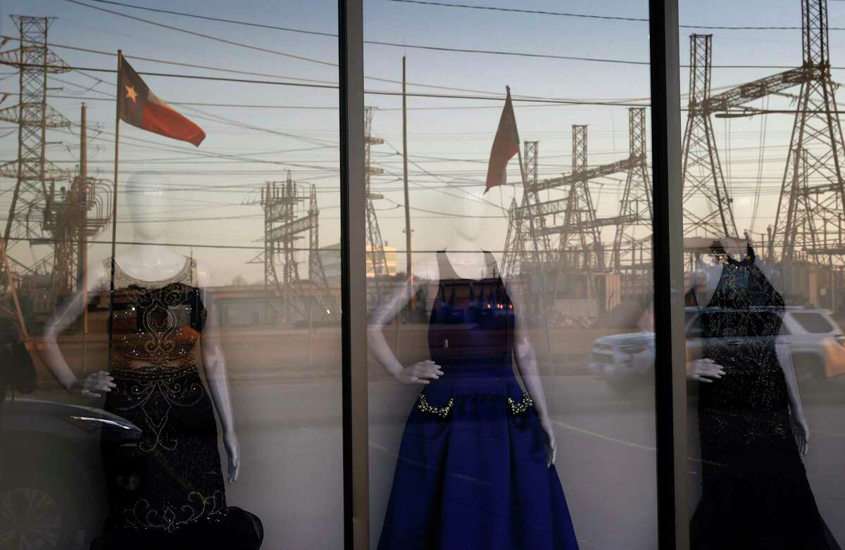 HOUSTON, TEXAS - FEBRUARY 21: An electrical substation is reflected in the window of a dress shop on February 21, 2021 in Houston, Texas. Millions of Texans lost their power when winter storm Uri hit the state and knocked out coal, natural gas and nuclear plants that were unprepared for the freezing temperatures brought on by the storm. Wind turbines that provide an estimated 24 percent of energy to the state became inoperable when they froze. (Photo by Justin Sullivan/Getty Images)