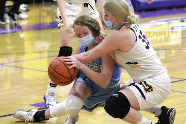 Jersey's Kari Krueger is fouled by CM's Claire Christeson (left) after securing a defensive rebound in the second half of their Mississippi Valley Conference girls basketball game Monday night in Bethalto.
