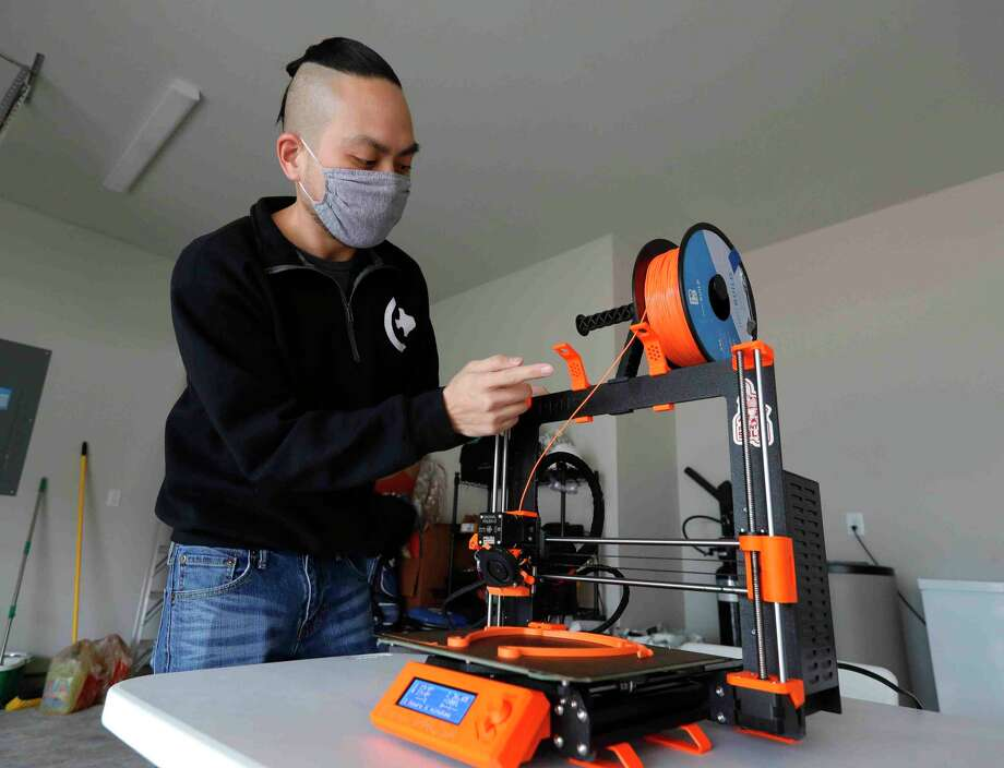 William Vo talks about the process of 3D printing a face mask, Thursday, Feb. 11, 2021, in Shenandoah. Members of College Park High School's Texas Torque robotics team have made more than 7,000 face masks for health care workers across the country. Photo: Jason Fochtman, Houston Chronicle / Staff Photographer / 2021 © Houston Chronicle