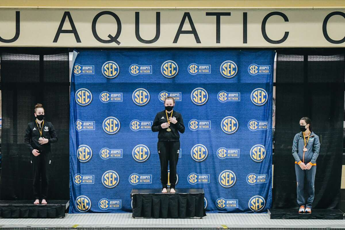 Lee grad and Texas A&M senior Charlye Campbell stands atop the podium after winning the women's 3-meter at the SEC Diving Championships, Feb. 18 in Columbia, Missouri. Photo courtesy of Texas A&MAthletics.