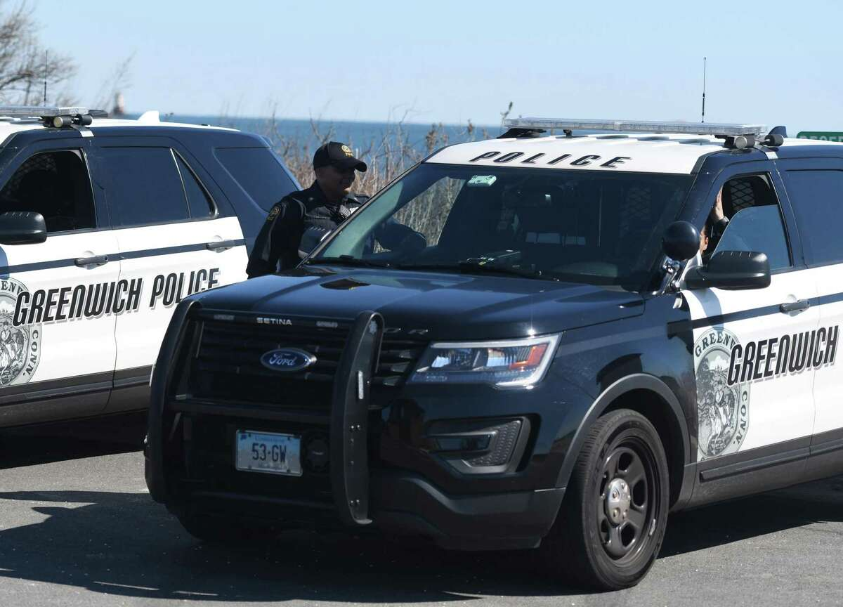 Greenwich police officers keep watch over Greenwich Point Park in Old Greenwich, Conn. Sunday, March 15, 2020.
