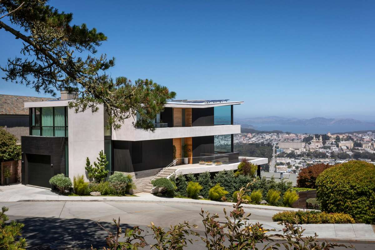 The home has a two-car garage, six bedrooms and seven bathrooms and sits on a large corner lot across from Sutro Tower.