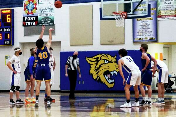 Morley Stanwood senior Carter Veldkamp attempts a free-throw shot during Monday night's game against Evart. (Pioneer photo/Joe Judd)