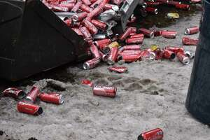 A truck hit a bridge on the Hutchinson River Parkway, spilling its load of energy drink onto the roadway on Tuesday morning.