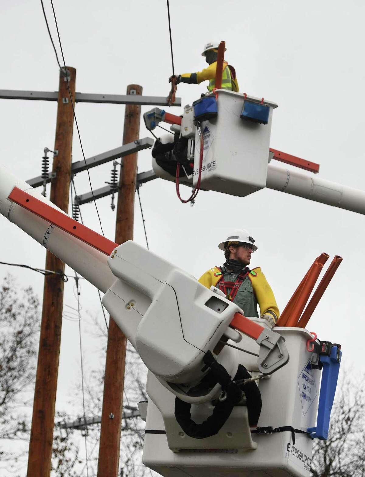 Eversource Energy workers demonstrate the steps involved in power restoration at the company's training site in Berlin, Conn. on Wednesday, October 28, 2020.