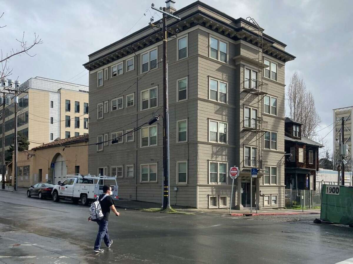 The eight-unit apartment building at 1921 Walnut St. on the edge of downtown Berkeley is owned by UC Berkeley, which intends to demolish it as part of a larger plan to build 14 stories of student housing on the block. Some of the rent-controlled tenants in the building, however, are opposed to being displaced.