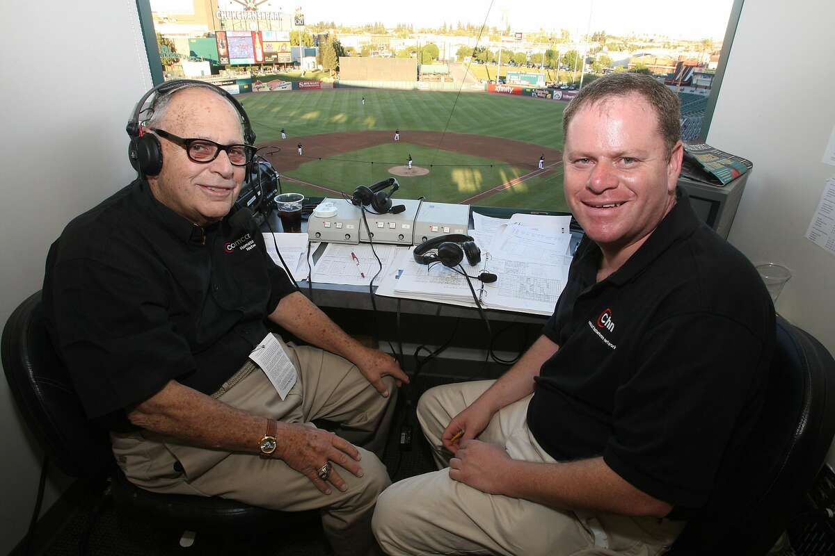 Doug Greenwald, right, with his father Hank in the broadcast booth at Chukchansi Park, home of the Fresno Grizzlies.