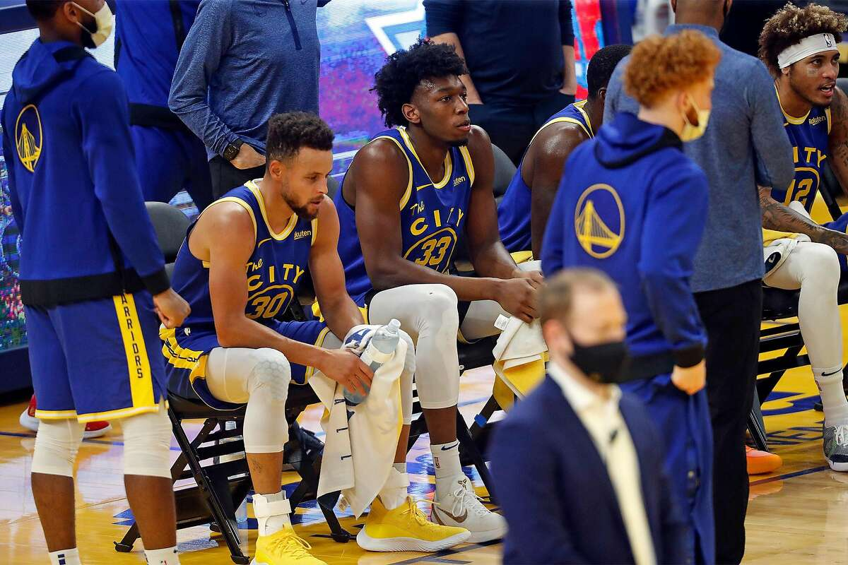Golden State Warriors' James Wiseman and Stephen Curry during time out while playing New York Knicks during NBA game at Chase Center in San Francisco, Calif., on Thursday, January 21, 2021.