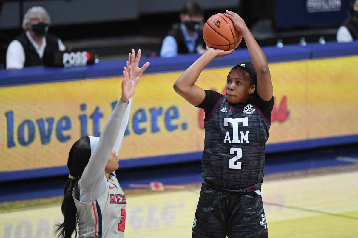 Texas A&M guard Aaliyah Wilson (2) takes a shot over Mississippi guard Donnetta Johnson (3) during the first half of an NCAA college basketball game in Oxford, Miss., Sunday, Feb. 21, 2021. (AP Photo/Thomas Graning)