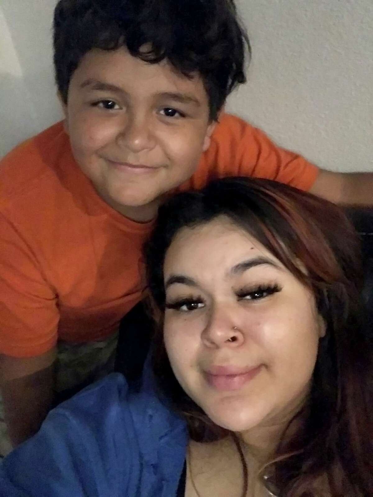 Jayden Rico, 10, shown with his cousin Shantel Barrera, was shot Monday night, Feb. 22, 2021, at a West Side apartment complex in the 1700 block of South Hamilton Avenue. San Antonio police have said the shooting was accidental.