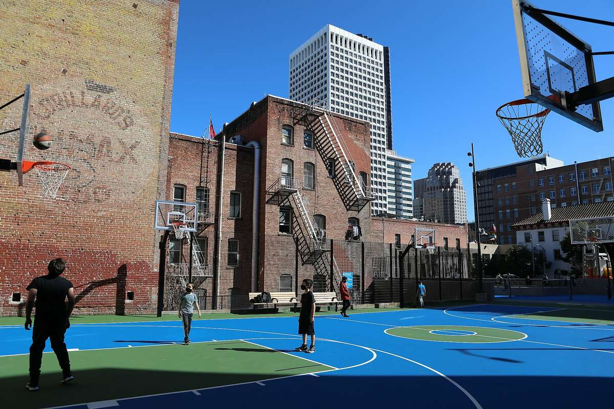 """Richard Chock of San Francisco plays basketball with sons Adam, 10, and Nate, 11, at the Willie """"Woo Woo"""" Wong Playground."""
