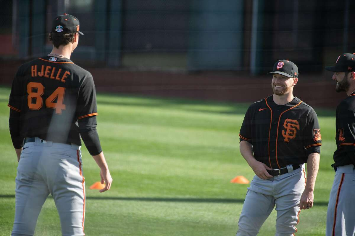 Sean Hjelle, 84, and James Sherfy, 64, laugh at San Francisco Giants practice before opening day of spring training in the Cactus League at Scottsdale Stadium on Tuesday, Feb. 23, 2021, in Scottsdale, Ariz.