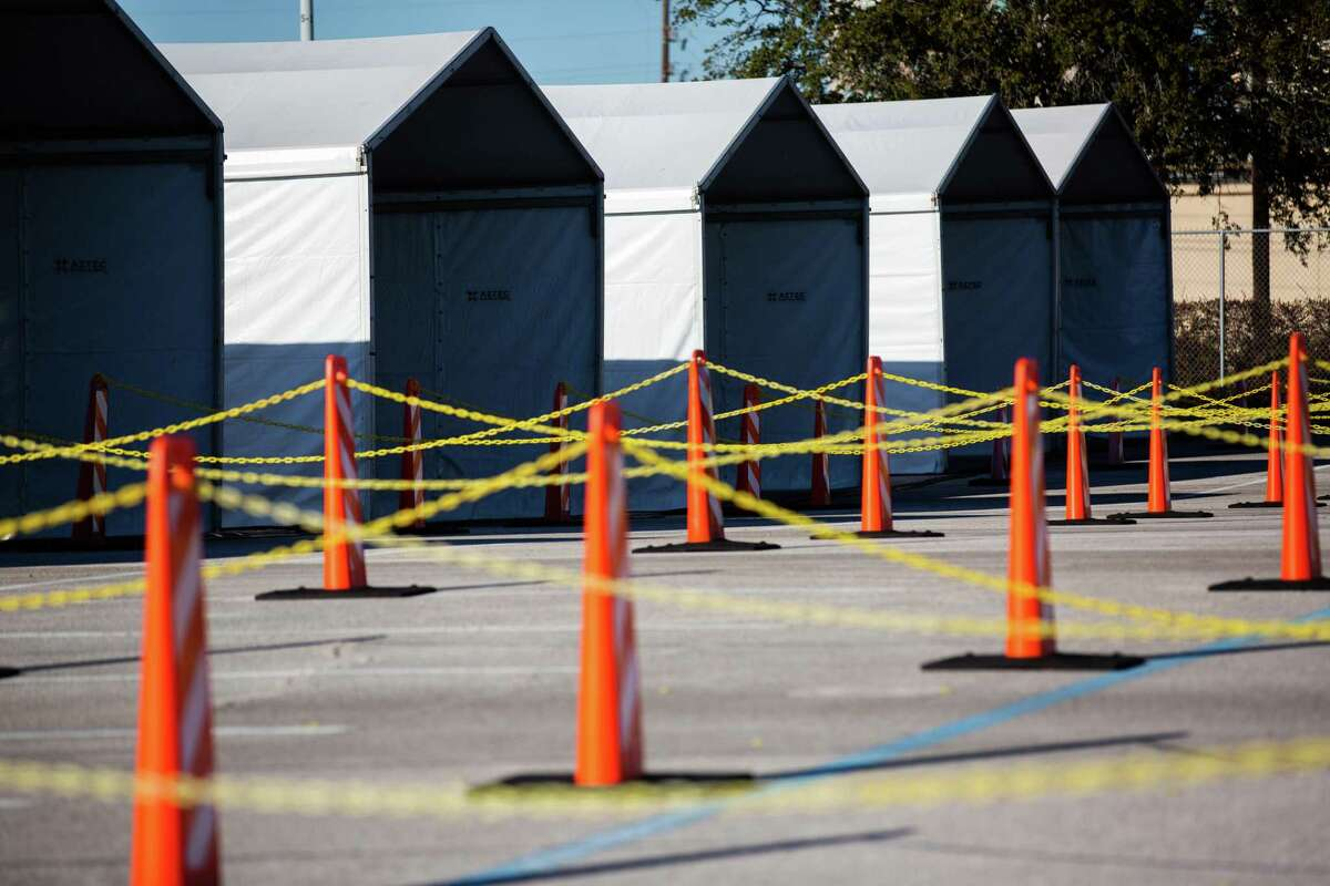 New federally-supported and state-managed COVID-19 vaccination clinic tents sit ready at NRG Park on Feb. 22, 2021, in Houston. The mass vaccination center will be able to vaccinate as many as 6,000 people daily.