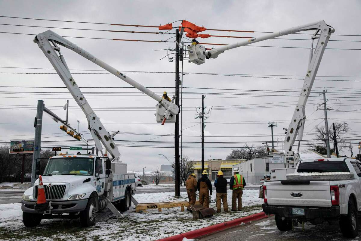 Utility workers repair a burnt-out switch in Austin, Texas, Thursday, Feb. 18, 2021. Scores of Texans who have reported skyrocketing electric bills in the storm's aftermath. For some whose electricity prices are not fixed and are instead tied to the fluctuating wholesale price, the spikes have been astronomical. (Tamir Kalifa/The New York Times)