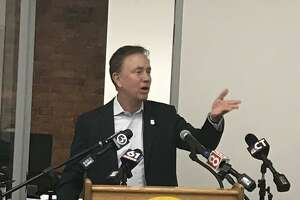 Connecticut Gov. Ned Lamont gestures to make a point during a press conference Tuesday in Hartford. Lamont said the COVID-19 pandemic has continued to remake the way people view Connecticut as a place to live and work.