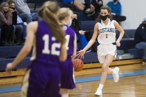 Meridian's Taylor Hopkins dribbles down the court during the Mustangs' game against Farwell Tuesday, Feb. 23, 2021 at Meridian Early College High School. (Katy Kildee/kkildee@mdn.net)