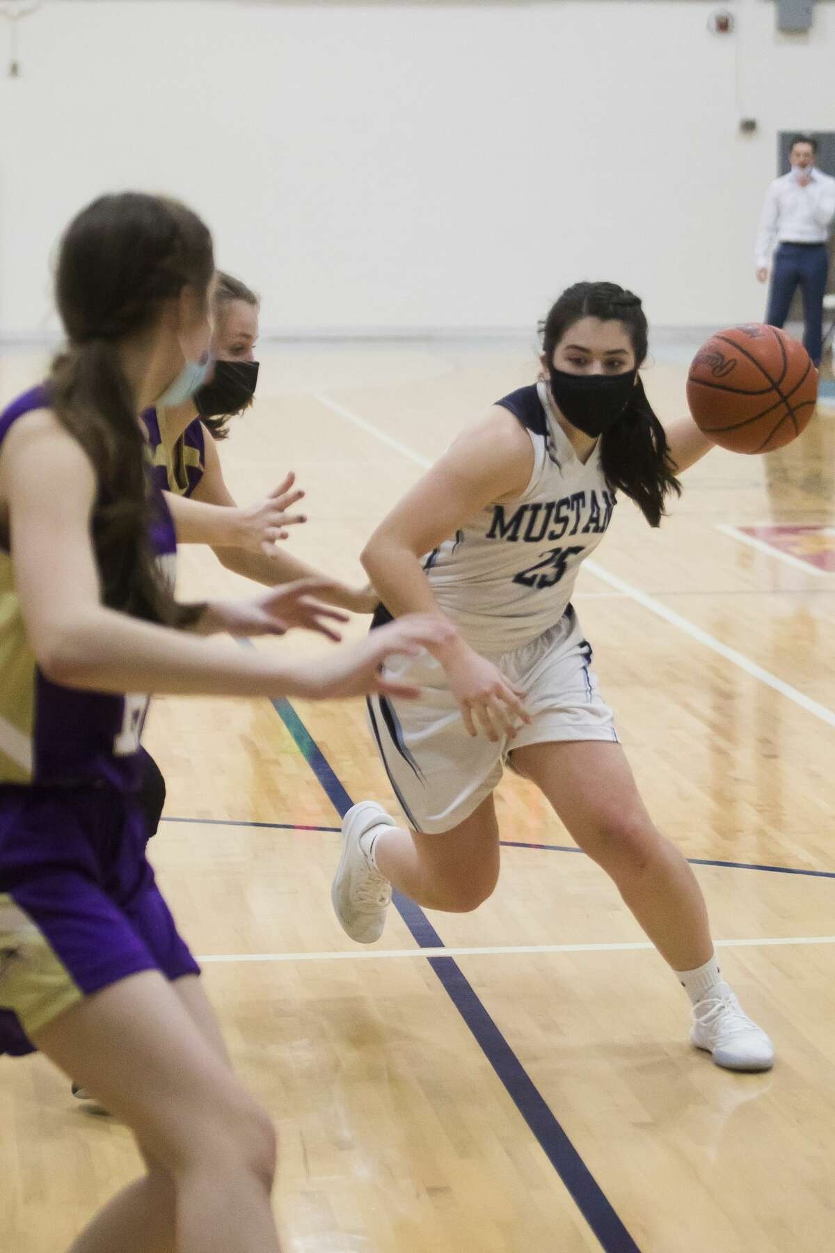 Meridian's Jenna Holzinger dribbles down the court during the Mustangs' game against Farwell Tuesday, Feb. 23, 2021 at Meridian Early College High School. (Katy Kildee/kkildee@mdn.net)