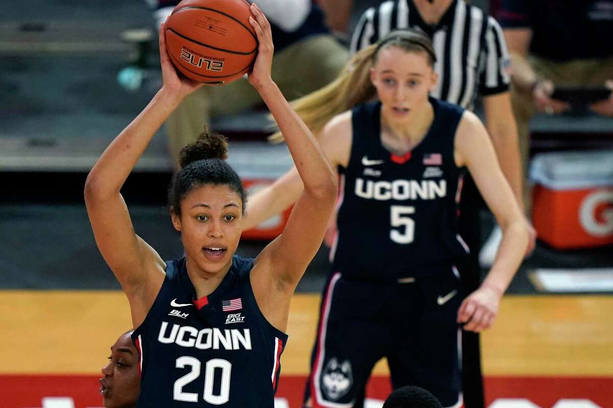 UConn's Olivia Nelson-Ododa (20) looks to pass as Paige Bueckers (5) looking on during a win at St. John's last week.