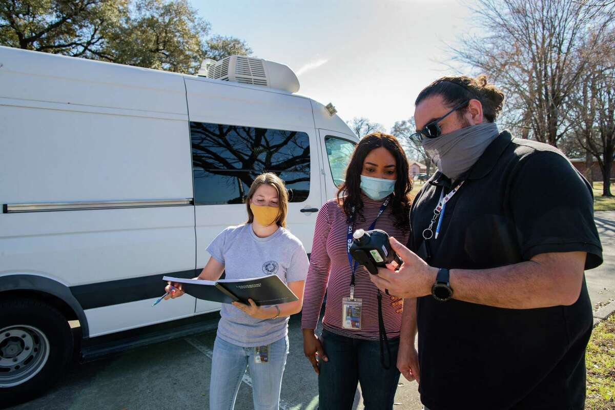 Texas Commission on Environmental Quality investigators Natalie Izral, Uchechi Nwaiwu and Sam Cortez conduct handheld air monitoring surveys in the Manchester community of Houston.
