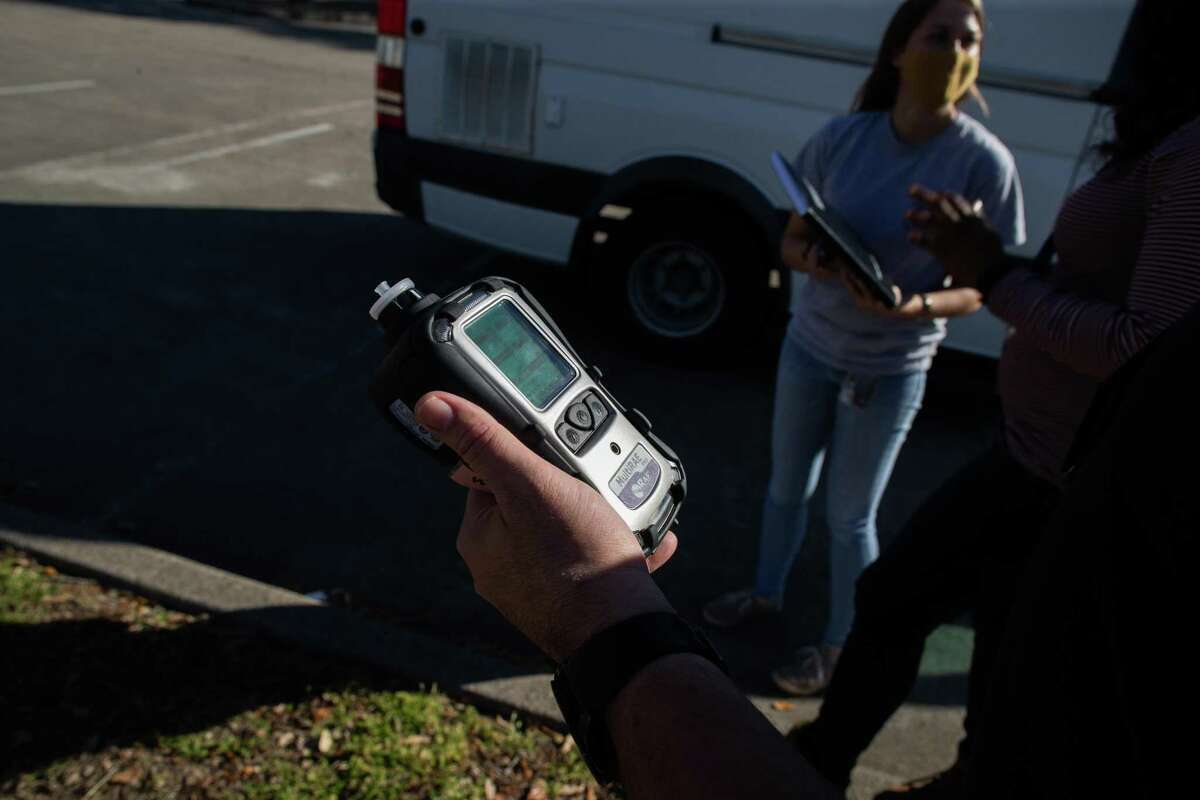 State environmental investigator Sam Cortez conducts handheld air monitoring surveys in the Manchester community of Houston, Tuesday, Feb. 23, 2021.