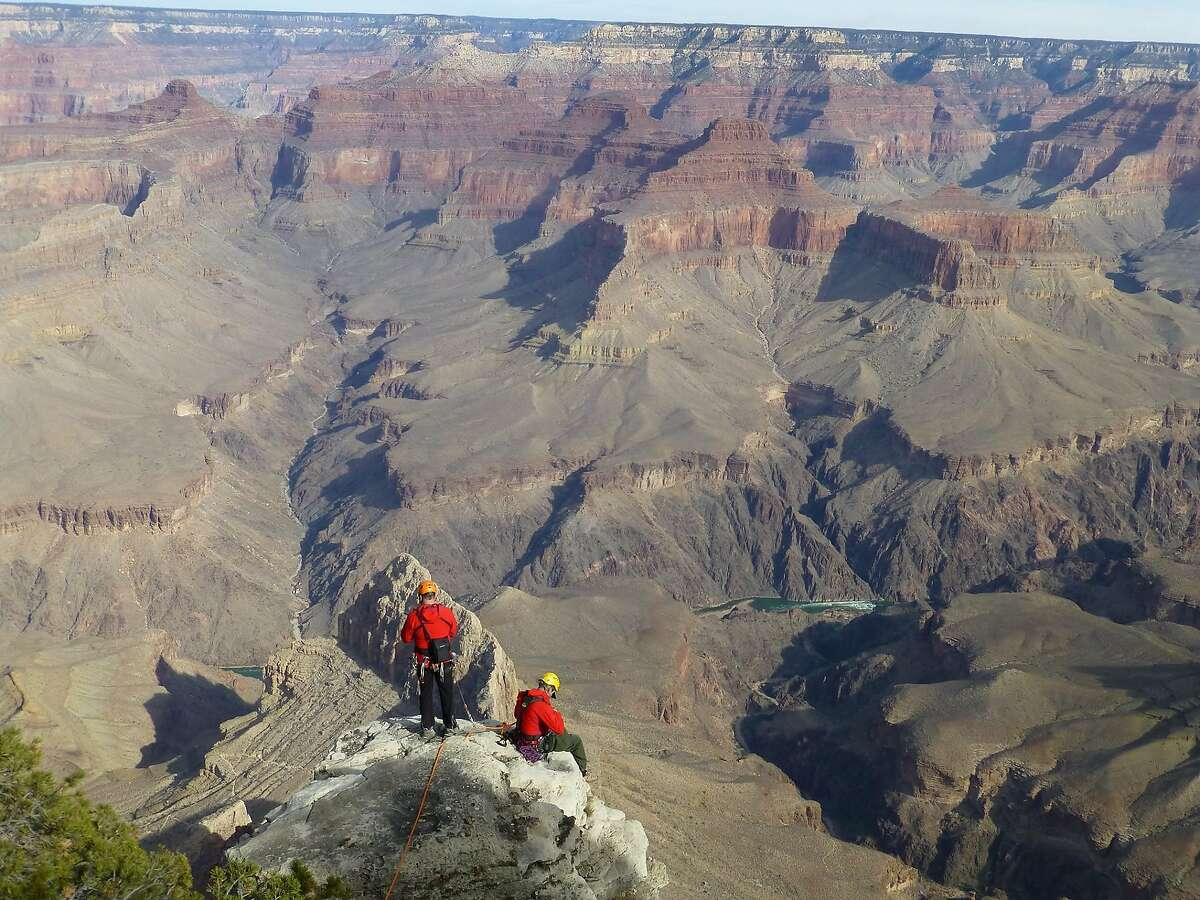 Two rangers stand at the edge of the Grand Canyon during a recovery operation for Woodside resident Lillian Meyn, whose body was found Feb. 23,2021.