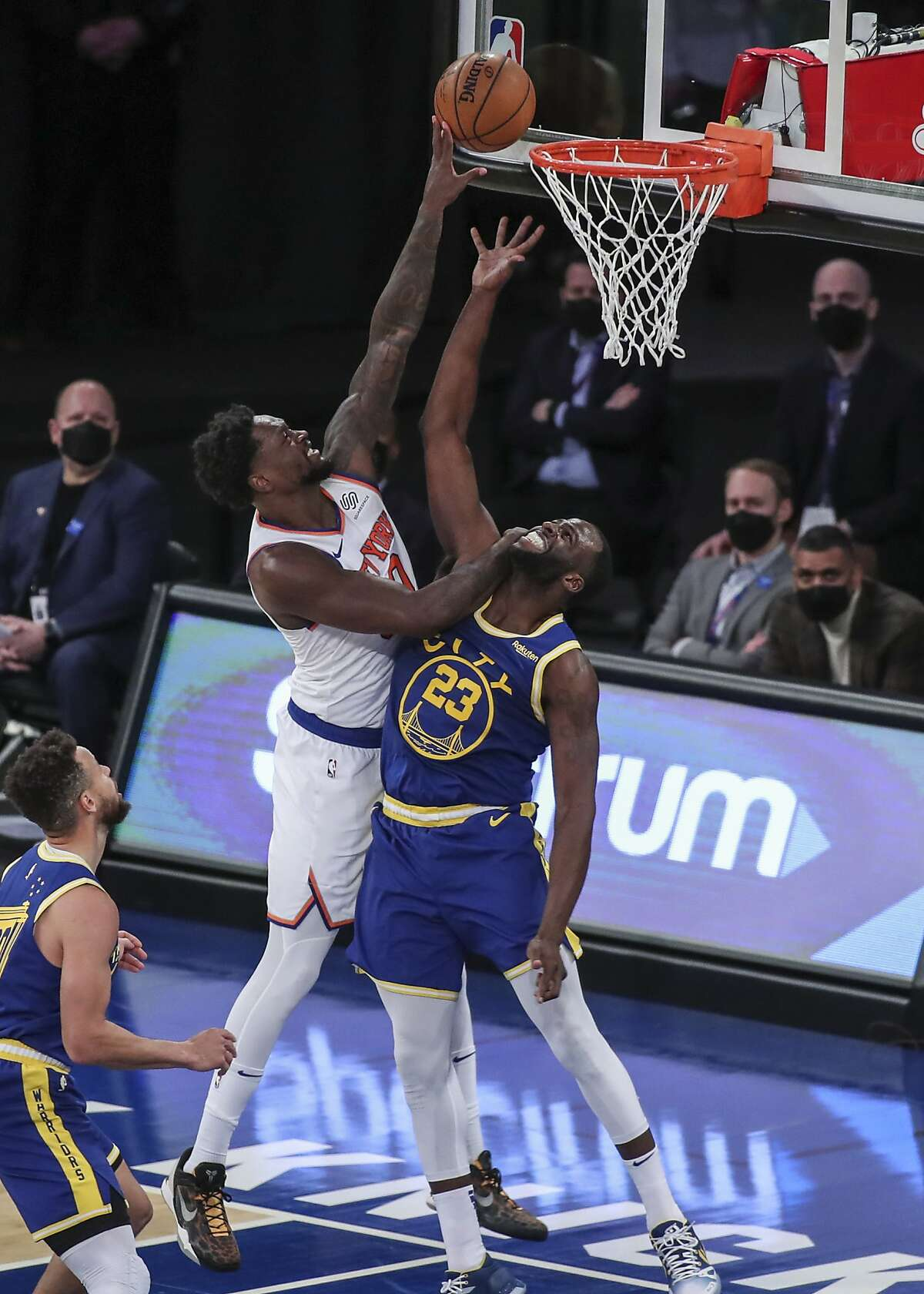 New York Knicks forward Julius Randle shoots over Golden State Warriors forward Draymond Green (23) during the second quarter of an NBA basketball game Tuesday, Feb. 23, 2021, in New York. (Wendell Cruz/Pool Photo via AP)