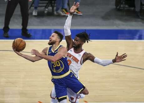 Golden State Warriors guard Stephen Curry (30) moves past New York Knicks center Nerlens Noel (3) during the first quarter of an NBA basketball game Tuesday, Feb. 23, 2021, in New York. (Wendell Cruz/Pool Photo via AP)