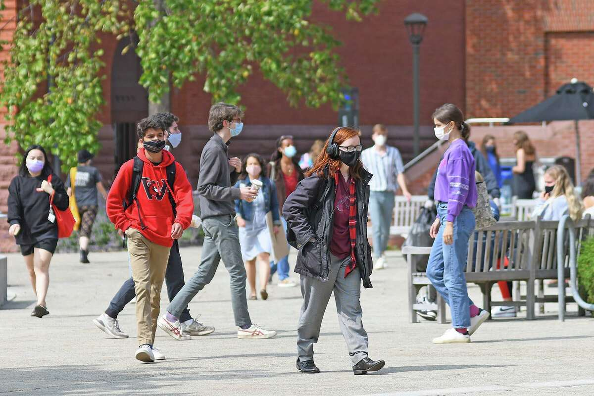 Wesleyan University students wear face masks on campus in Middletown during the pandemic.