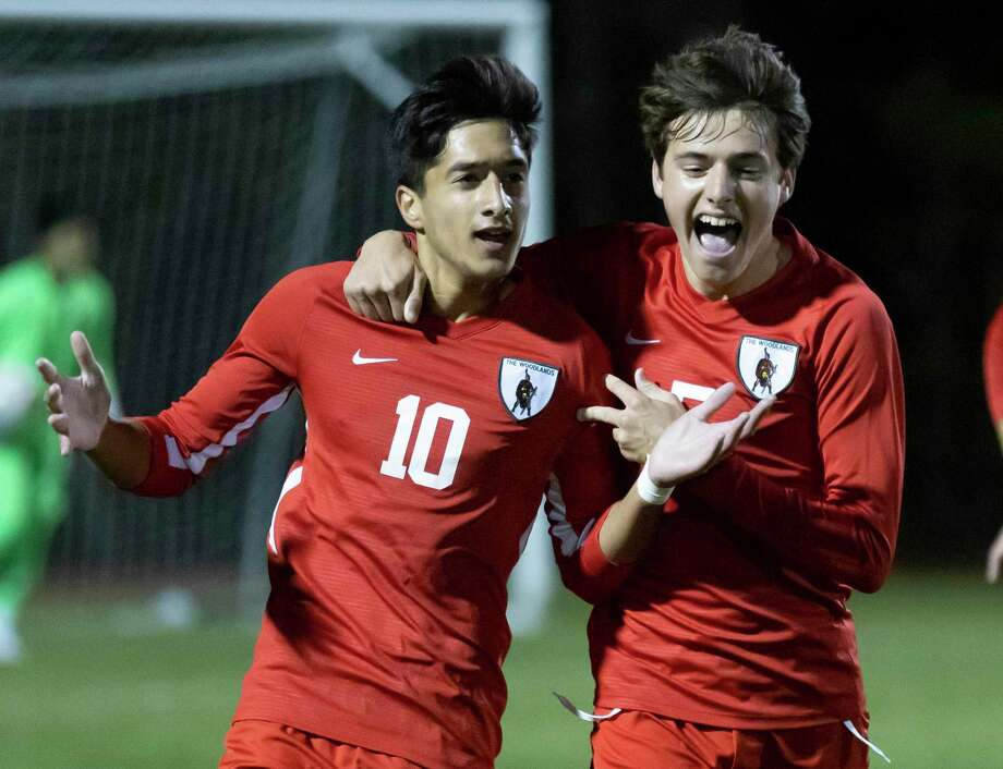 The Woodlands midfielder Andrew Davison (5) and midfielder Hasan Arif (10) react after they score during the first half of a District 13-6A boys soccer against Conroe at The Woodlands High School, Tuesday, Feb. 23, 2021, in The Woodlands. Photo: Gustavo Huerta, Houston Chronicle / Staff Photographer / Houston Chronicle © 2021