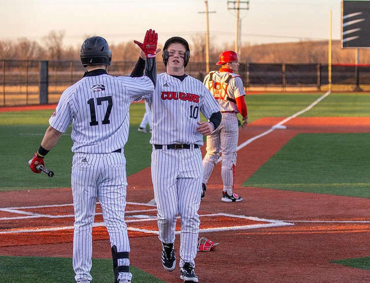 SIUE's Ole Arntson is congratulated at home plate by Josh Ohl during Tuesday's doubleheader against Illinois State in Edwardsville.