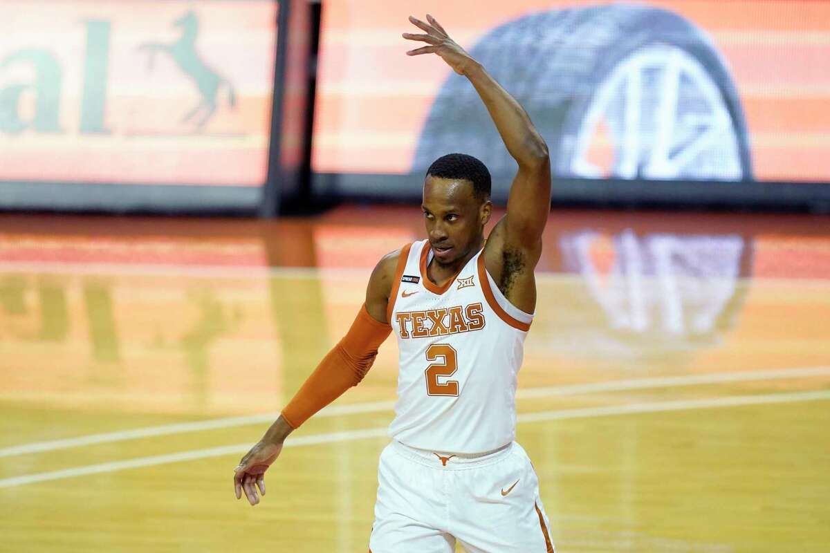 Texas' Matt Coleman, who did a bit of everything with 11 points, nine rebounds and five assists, celebrates in the second half.