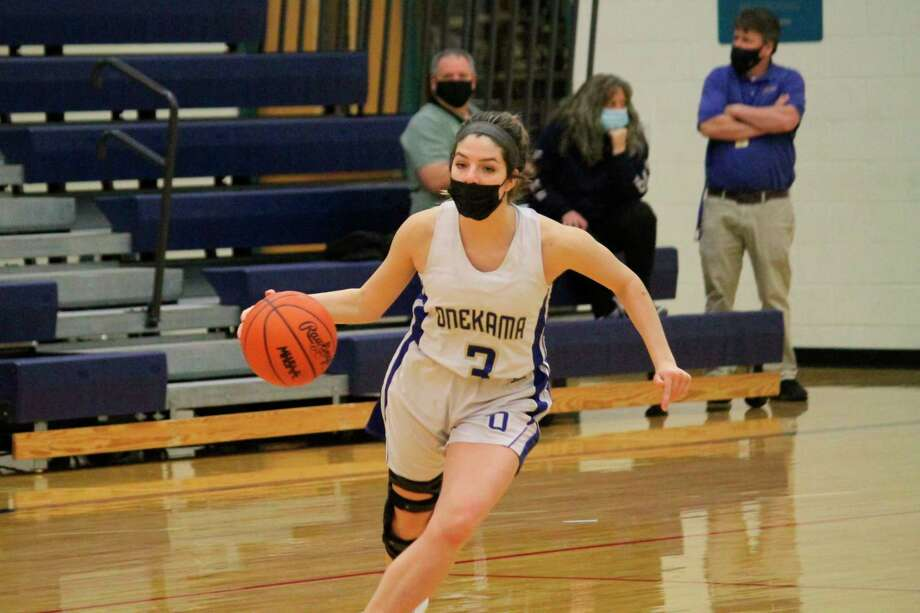Sara Bromley drives up the court with the basketball during a loss to Benzie Central on Feb. 18. (News Advocate file photo)