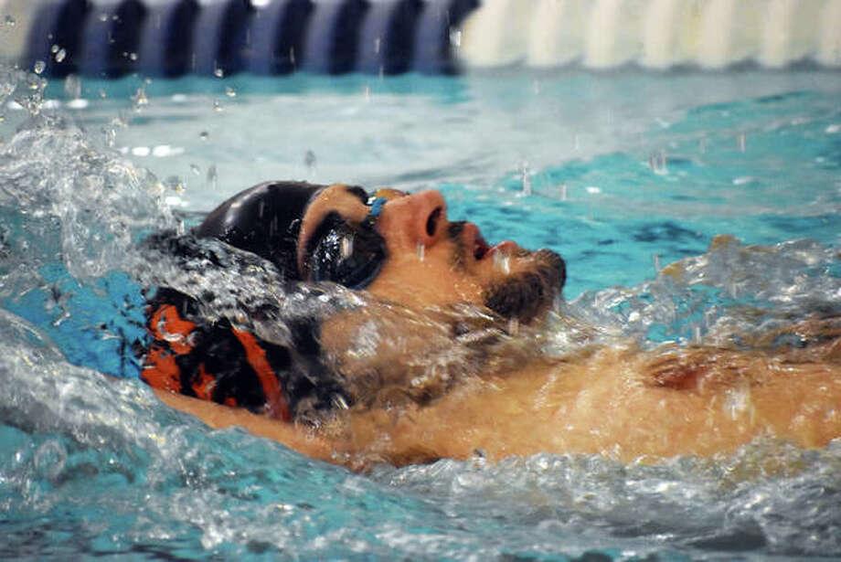 Edwardsville's Trent Sholl competes in the 100-yard backstroke during Tuesday's dual meet against O'Fallon inside Chuck Fruit Aquatic Center. Photo: Matt Kamp|The Intelligencer