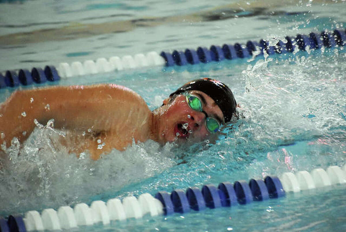 Edwardsville's Cohen Osborn competes in the 500-yard freestyle in Tuesday's dual meet against O'Fallon.