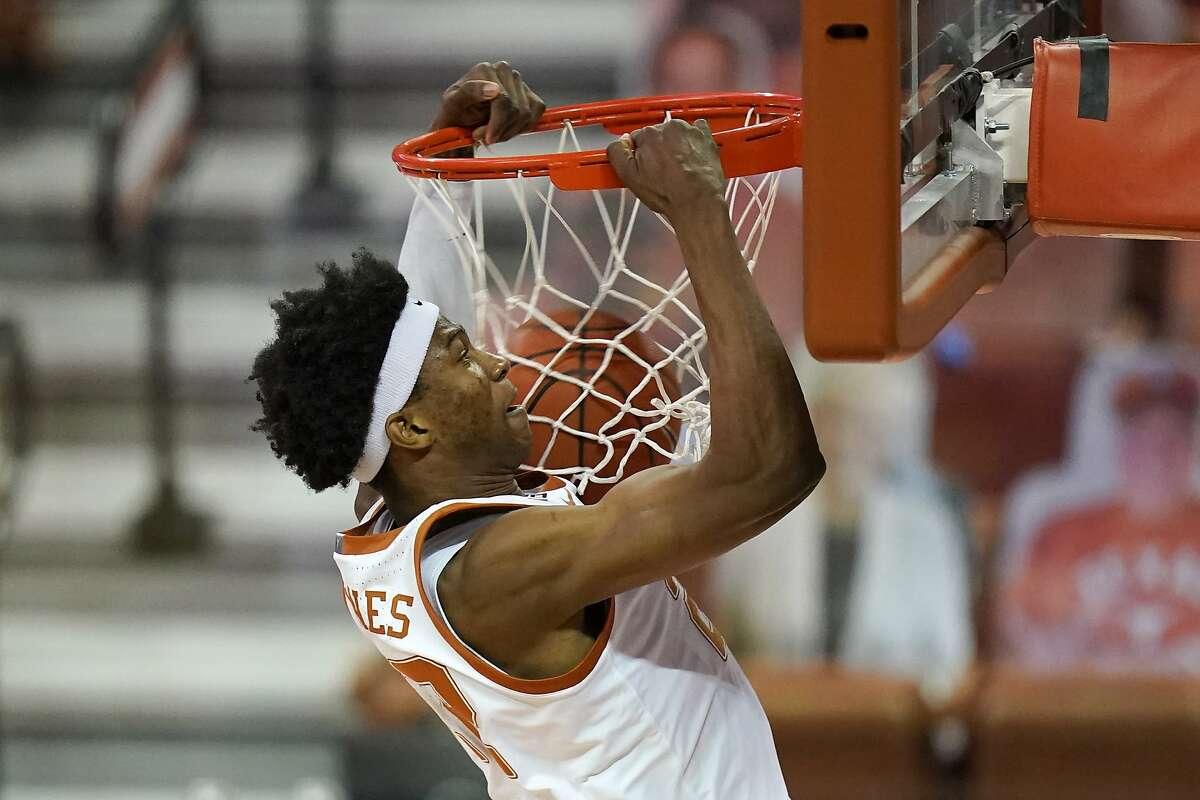 Texas forward Kai Jones dunks the ball during the first half of an NCAA college basketball game against Kansas, Tuesday, Feb. 23, 2021, in Austin, Texas. (AP Photo/Eric Gay)