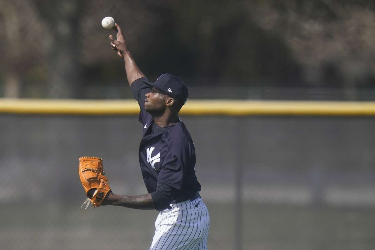 New York Yankees' Domingo German during a spring training baseball workout Monday, Feb. 22, 2021, in Tampa, Fla. (AP Photo/Frank Franklin II)