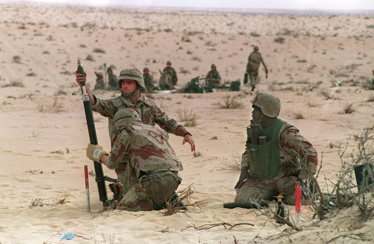 """US Marines from the 3rd Battilion, 6th Marines fire a 60mm mortar during a live fire exercise in January 1991 in the desert of Saudi Arabia as part of the """"Operation Desert Shield."""" (Robert Sullivan/AFP/Getty Images/TNS)"""