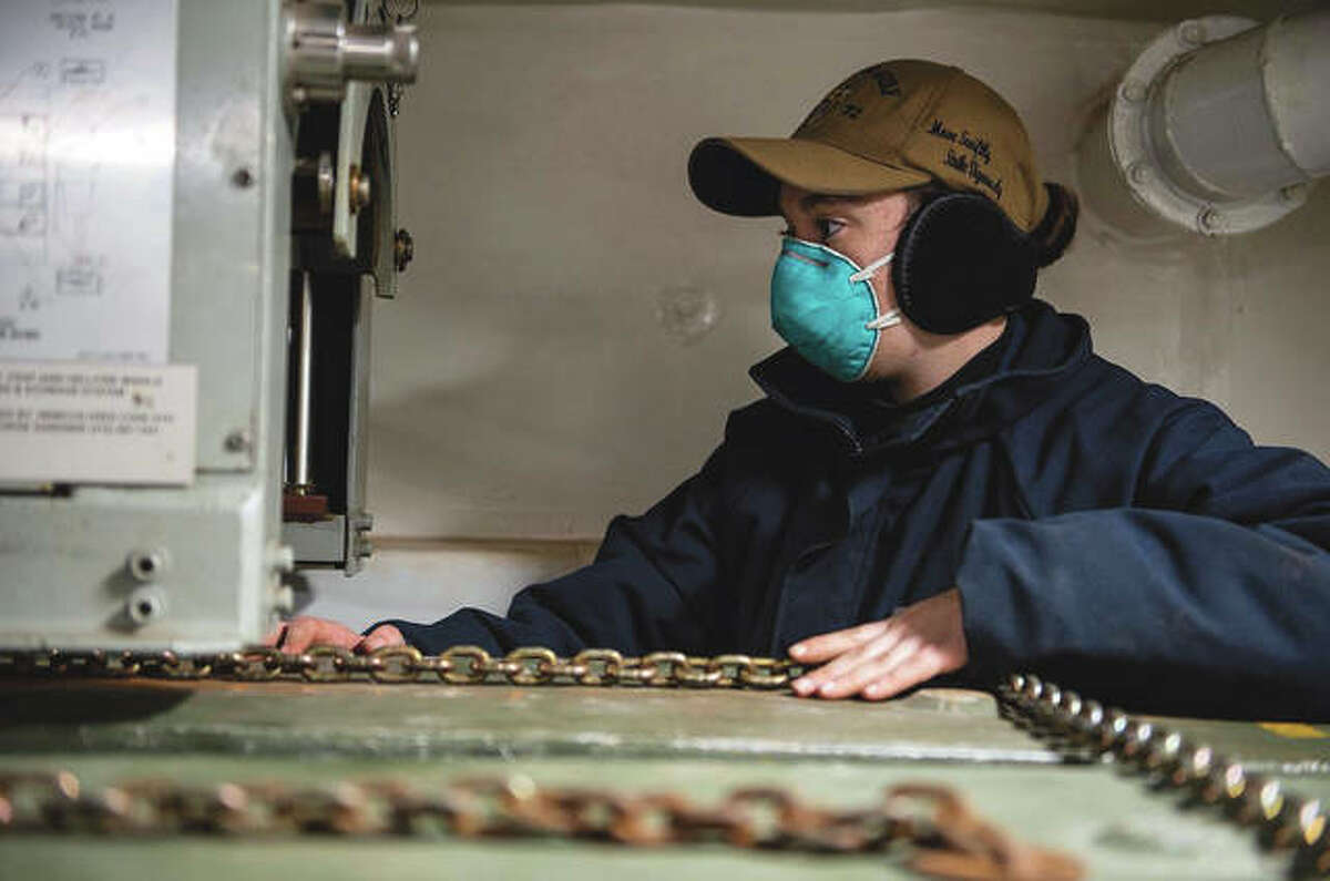 Gunner's mate Seaman Bailee Hartshorn of Elsah secures ordnance aboard the Ticonderoga-class guided-missile cruiser USS Vella Gulf. The USS Vella Gulf was pierside at Naval Weapons Station Yorktown in Virginia while conducting routine maintenance.