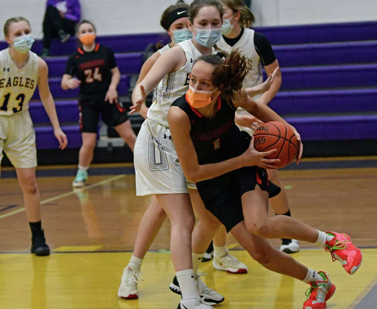 Cambridge's Lilly Phillips comes out of the paint as she drives baseline during a basketball game against Duanesburg on Tuesday, Feb. 23, 2021 in Delanson, N.Y. (Lori Van Buren/Times Union)