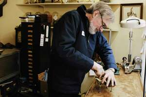James Dunbrook,a freelance horologist at The Clock Works, repairs a time and strike movement for a calendar clock on Tuesday, Feb. 23, 2021, in Schenectady, N.Y.     (Paul Buckowski/Times Union)