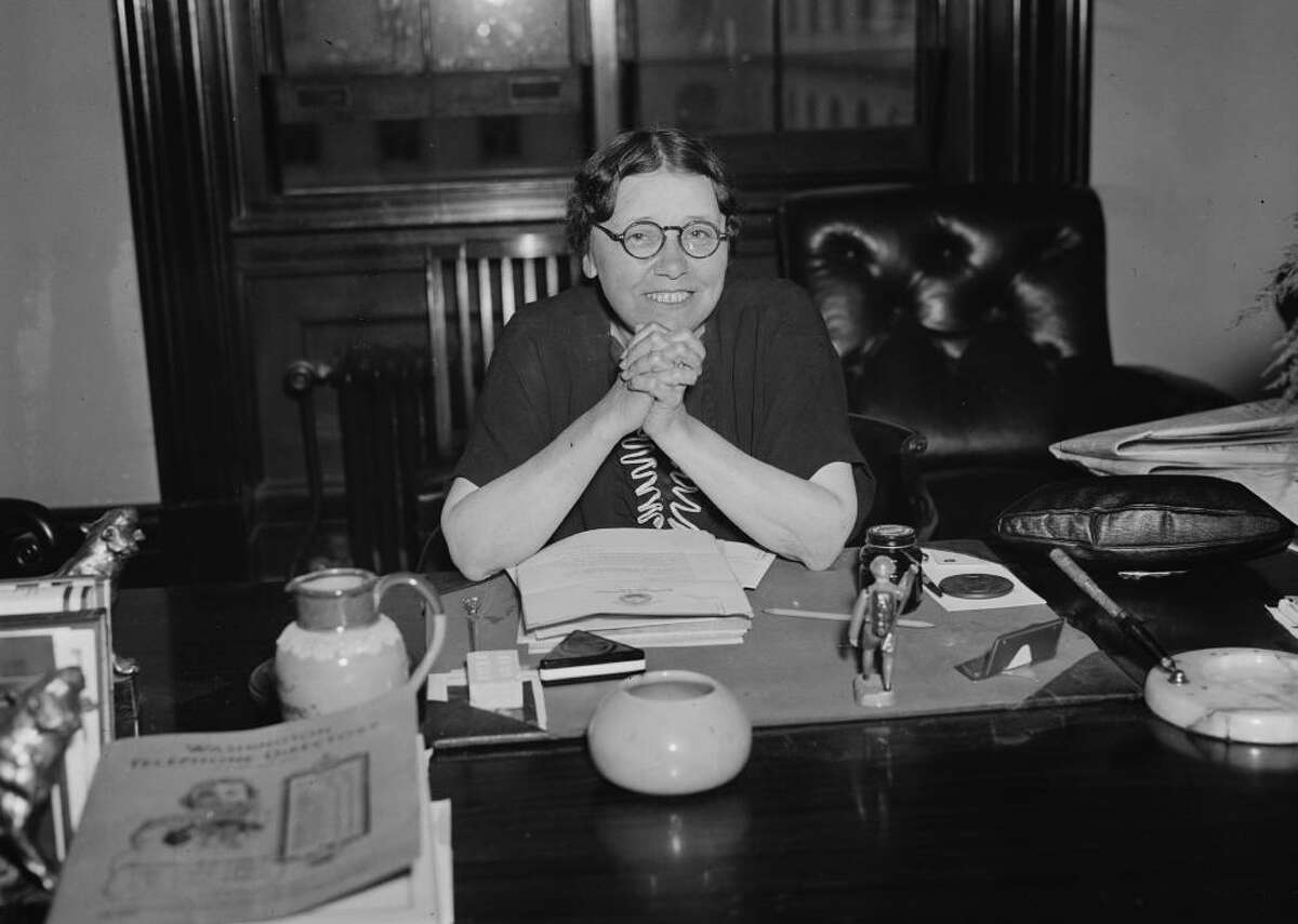 1932 - Women in office: 193 - Political party: 77 Democratic, 109 Republican, 5 nonpartisan, 2 other party - Level of government: 8 federal executive or Congress, 171 state legislature, 14 statewide executive, 0 D.C. or other territory legislature Hattie Wyatt Caraway became the first woman to be elected to a full term in the United States Senate in 1932. Her husband, Thaddeus Caraway, had initially won the Arkansas seat, but died while holding the office in 1931. Thanks to a now-defunct practice called the widow's mandate, Hattie took over the job for the rest of that year, then won reelection on her own merits in 1932 with 92% of the vote. [Pictured: Hattie Wyatt Caraway at her desk in WashingtonD.C., 1936.]