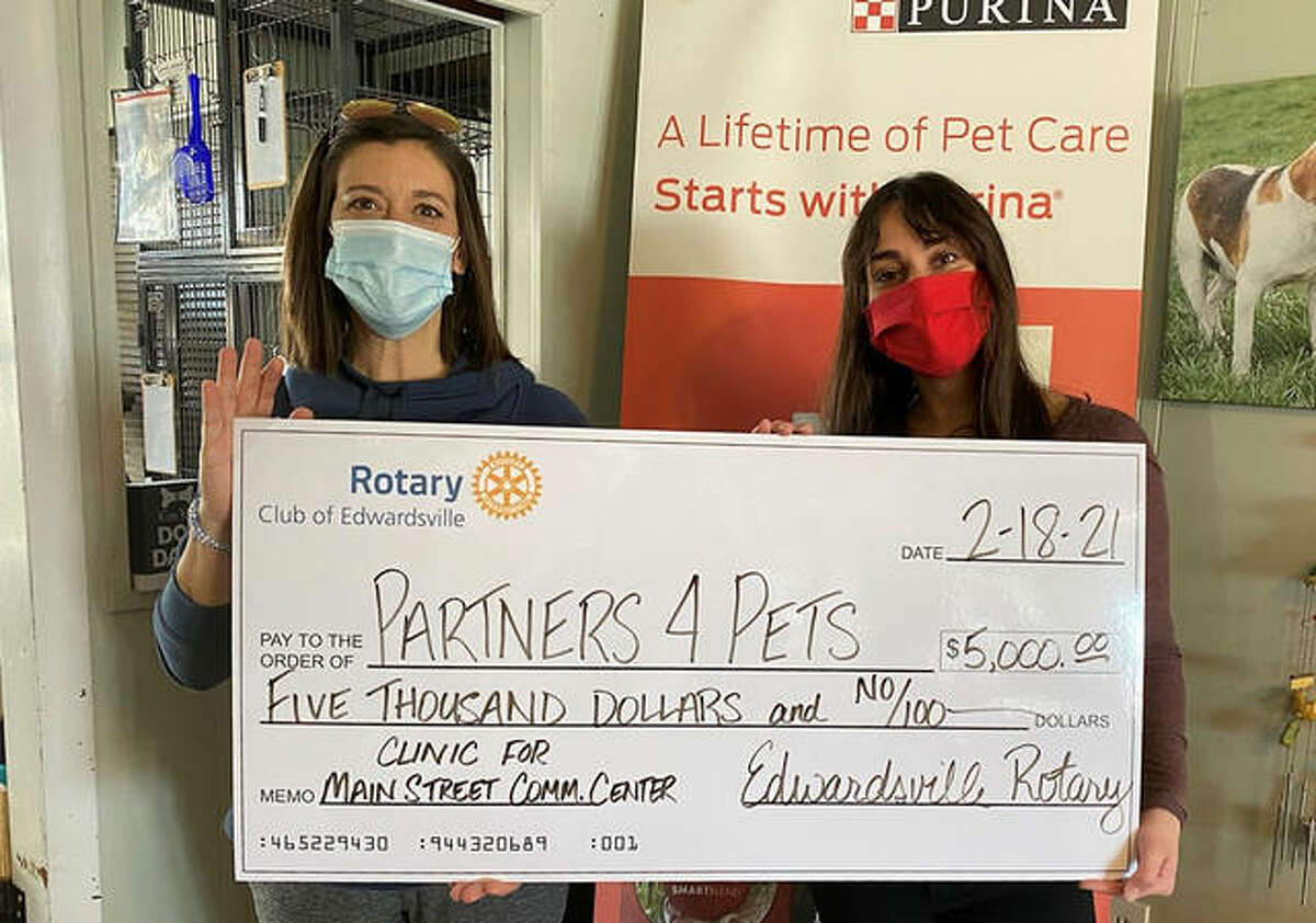 Gina Grebing, left, from the Edwardsville Rotary Club presents a check for a $5,000 grant to Erika Pratte, director of Partners for Pets. The grant is for low-income residents of District 7 as well as seniors affiliated with Main Street Community Center, and will cover the cost of 10 clinics, which include services such as vaccines and spaying/neutering.