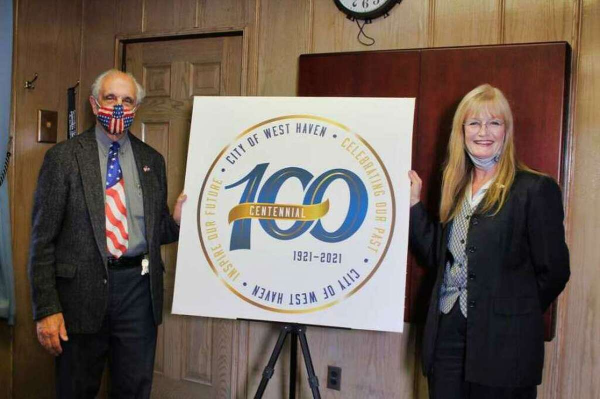 In this file photo, Mayor Nancy R. Rossi and her executive assistant, Louis P. Esposito Jr., reveal the logo for West Haven's centennial celebration in 2021.