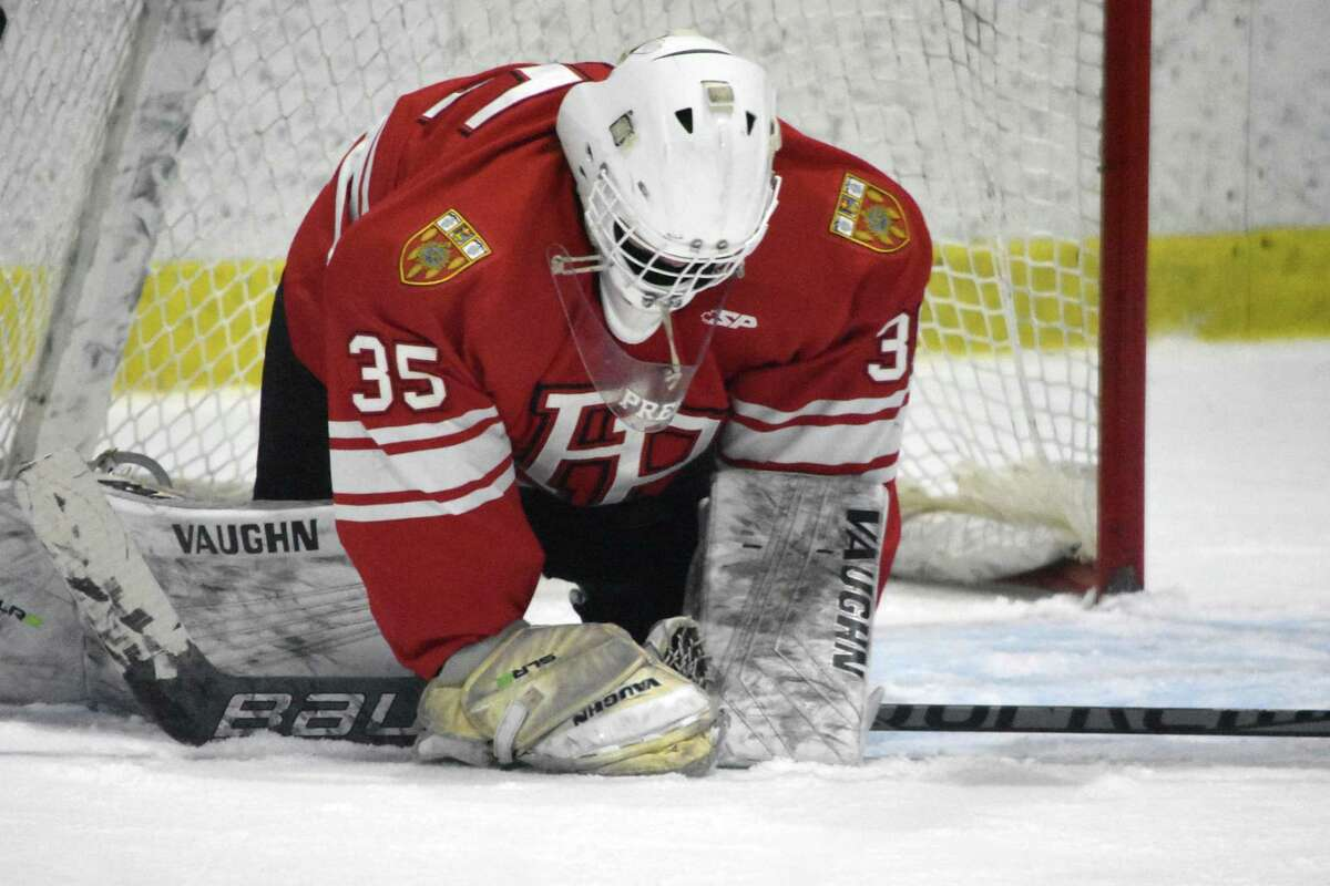 Fairfield Prep's Tommy Martin makes a save against Darien at the Darien Ice House on Saturday, February 13, 2021.