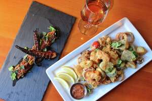 """""""Noshables"""" at Black Rock Social House include frito misto (right) with shrimp, calamari and peppers. At left is an octopus salad."""