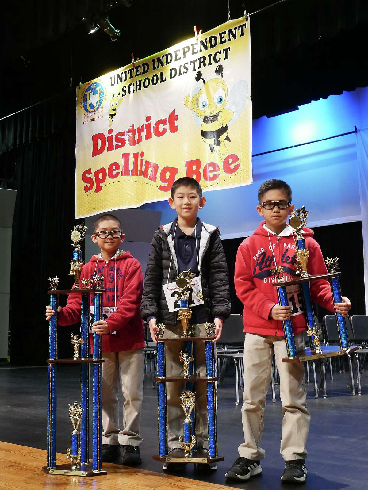 Lamar Bruni Vergara Middle School 6th grade student Emmanuel Rimocal holds the first place trophy he won at the United ISD District Spelling Bee, Thursday, January 31, 2019 at the UISD Student Activity Complex Auditorium. This is Rimocal's second victory at the district level. He was competing against his younger brother Nathaniel, a 4th grade student at Kennedy-Zapata Elementary, who finished in third place.
