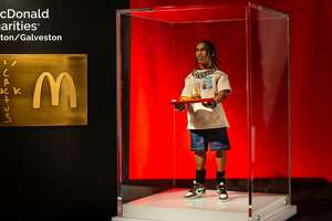 Travis Scott and McDonald's donated a rare action figure for auction at Houston's Ronald McDonald House.