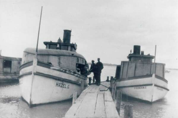 Two fishing boats tied up at the South Manitou Island dock-Frances C. from the Rodal & Sons fisheries of Frankfort, and the Hazel C. of Chapin fisheries. (Courtesy Photo)
