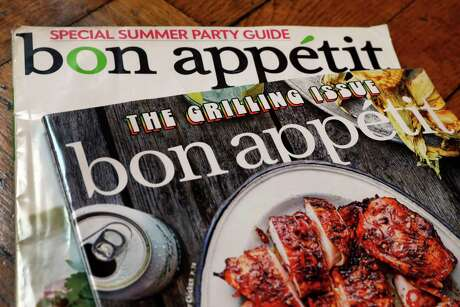 "Two covers of Bon Appetit magazine are shown in this photo, in New York, Wednesday, June 10, 2020. The staff at Bon Appetit, whose top editor resigned after a revolt by the journalists there after an offensive photo of him circulated online amid longstanding issues over treatment of people of color, said in a statement Wednesday, June 10, that ""our mastheads have been far too white for far too long"" and the magazine was making changes. (AP Photo/Richard Drew)"