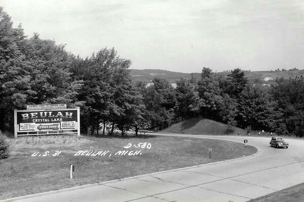"Beulah welcome sign of 1930s on US 31 at the turn-off into Beulah, touting the beach ""tourist camp"" and the smelt. (Courtesy Photo)"